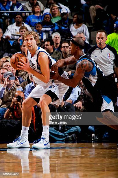 Dirk Nowitzki of the Dallas Mavericks posts up against Dante Cunningham of the Minnesota Timberwolves on January 14 2013 at the American Airlines...