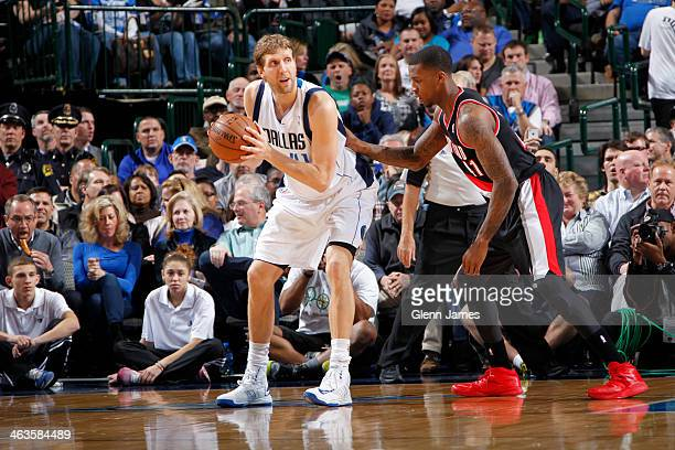 Dirk Nowitzki of the Dallas Mavericks posts up against Thomas Robinson of the Portland Trail Blazers on January 18 2014 at the American Airlines...