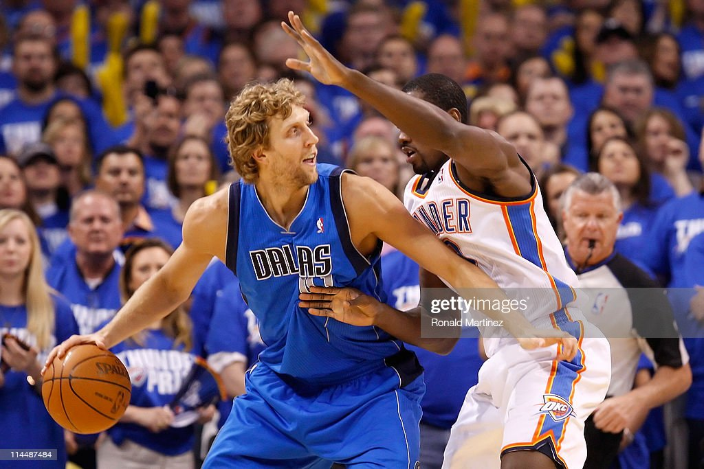 Dirk Nowitzki #41 of the Dallas Mavericks posts up Serge Ibaka #9 of the Oklahoma City Thunder in the first quarter in Game Three of the Western Conference Finals during the 2011 NBA Playoffs at Oklahoma City Arena on May 21, 2011 in Oklahoma City, Oklahoma.