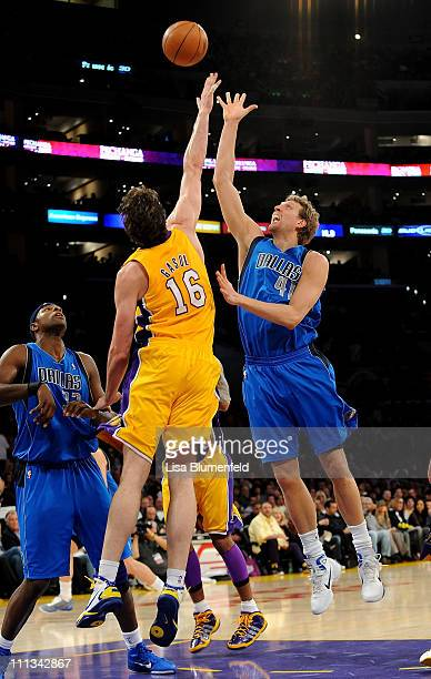 Dirk Nowitzki of the Dallas Mavericks puts a shot up against Pau Gasol of the Los Angeles Lakers at Staples Center on March 31 2011 in Los Angeles...