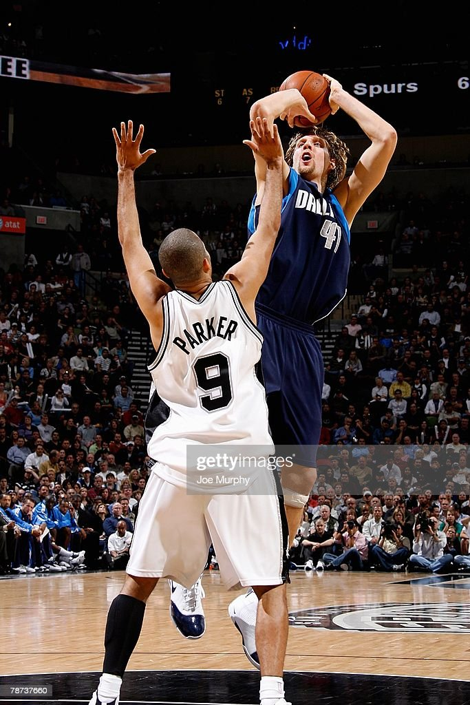 Dirk Nowitzki #41 of the Dallas Mavericks puts a shot up over Tony Parker #9 of the San Antonio Spurs during the game on December 5, 2007 at the AT&T Center in San Antonio, Texas. The Spurs won 97-95.