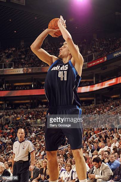Dirk Nowitzki of the Dallas Mavericks puts up a shot during the NBA game against the Phoenix Suns at US Airways Center on November 9 2006 in Phoenix...