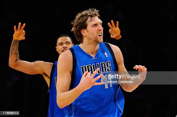 Dirk Nowitzki of the Dallas Mavericks reacts after making a threepointer in the third quarter while taking on the Los Angeles Lakers in Game Two of...