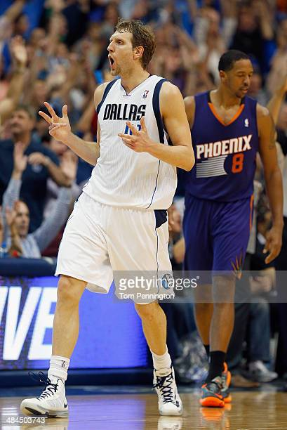 Dirk Nowitzki of the Dallas Mavericks reacts after making a three point shot against the Phoenix Suns at American Airlines Center on April 12 2014 in...