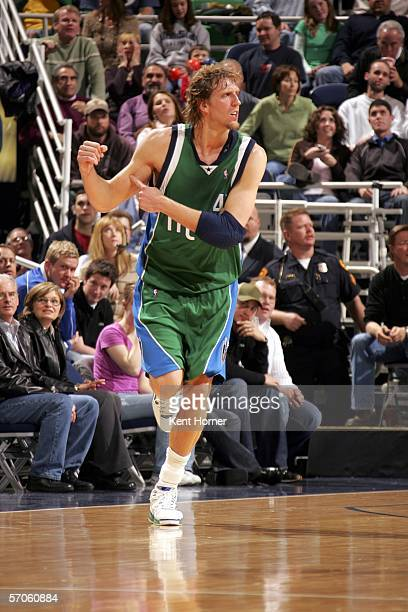 Dirk Nowitzki of the Dallas Mavericks reacts after scoring on a 3-point shoot against the Utah Jazz during their game on March 11, 2006 at the Delta...
