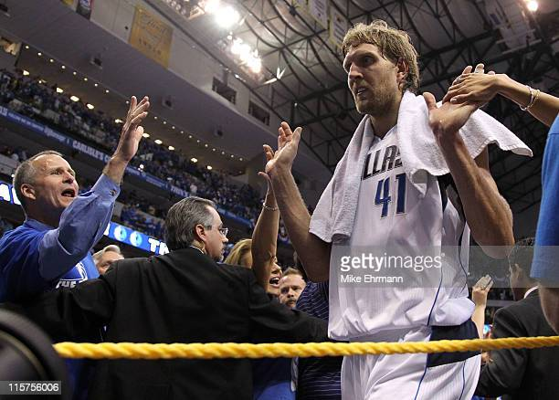 Dirk Nowitzki of the Dallas Mavericks reacts after the Mavericks defeated the Miami Heat 112103 in Game Five of the 2011 NBA Finals at American...