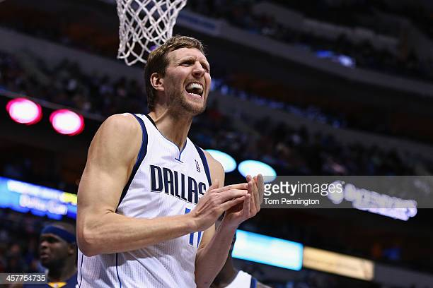 Dirk Nowitzki of the Dallas Mavericks reacts against the Memphis Grizzlies at American Airlines Center on December 18 2013 in Dallas Texas NOTE TO...