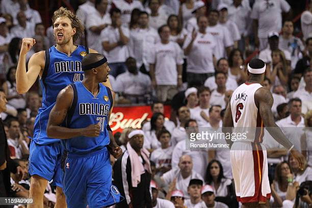 Dirk Nowitzki of the Dallas Mavericks reacts behind teammate Jason Terry after Nowitzki makes a jump shot in the fourth quarter while taking on the...