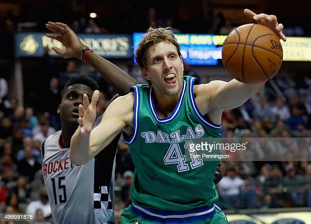 Dirk Nowitzki of the Dallas Mavericks rebounds the ball against Clint Capela of the Houston Rockets in the second half at American Airlines Center on...