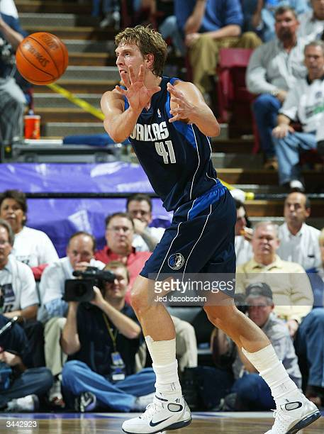 Dirk Nowitzki of the Dallas Mavericks receives a pass against the Sacramento Kings during game 1 of the Western Conference First Round of the NBA...