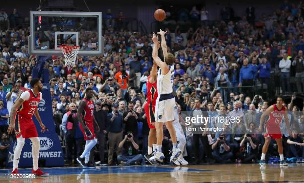 Dirk Nowitzki of the Dallas Mavericks scores a basket against Kenrich Williams of the New Orleans Pelicans to become the sixth alltime leading scorer...