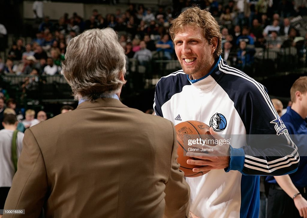 Dirk Nowitzki #41 of the Dallas Mavericks shares a laugh with head coach Paul Westphal of the Sacramento Kings during the game at the American Airlines Center on March 5, 2010 in Dallas, Texas. The Mavericks won 108-100.