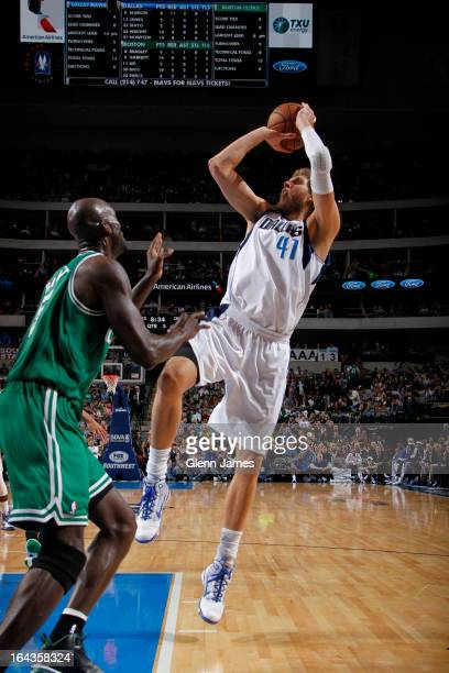 Dirk Nowitzki of the Dallas Mavericks shoots a fade away against Kevin Garnett of the Boston Celtics on March 22 2013 at the American Airlines Center...