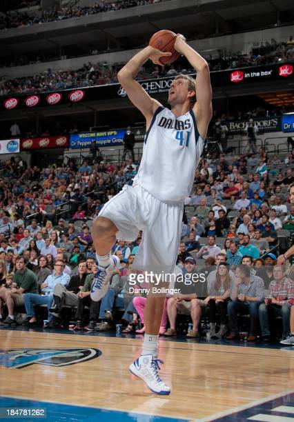 Dirk Nowitzki of the Dallas Mavericks shoots a fadeaway against the Orlando Magic on October 14 2013 at the American Airlines Center in Dallas Texas...