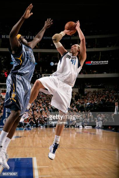 Dirk Nowitzki of the Dallas Mavericks shoots a fadeaway against Zach Randolph of the Memphis Grizzlies during a game at the American Airlines Center...