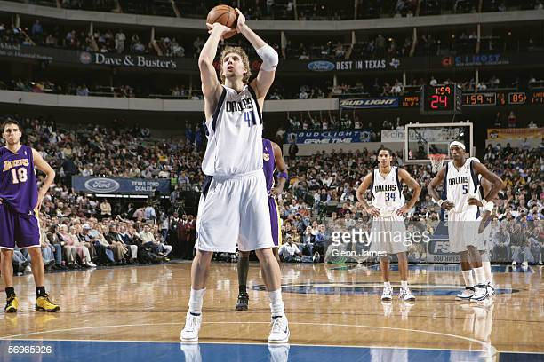 Dirk Nowitzki of the Dallas Mavericks shoots a free throw against the Los Angeles Lakers during the game at American Airlines Arena on February 7...