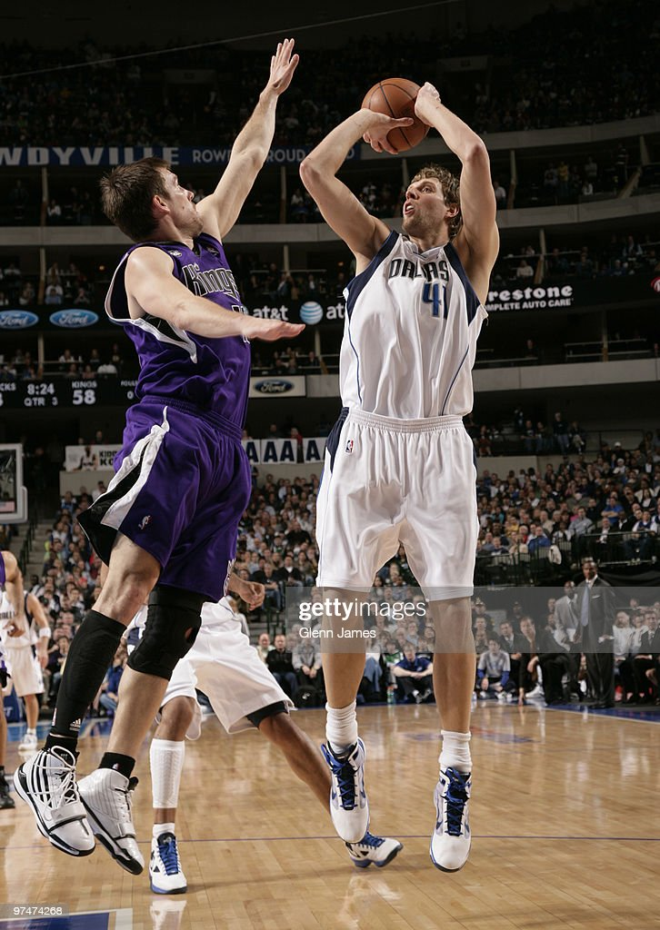 Dirk Nowitzki #41 of the Dallas Mavericks shoots a jumper against Beno Udrih #19 of the Sacramento Kings during a game at the American Airlines Center on March 5, 2010 in Dallas, Texas.