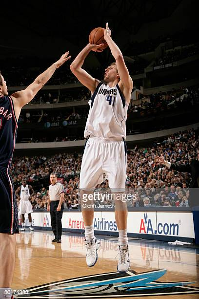 Dirk Nowitzki of the Dallas Mavericks shoots a jumper against the New Jersey Nets at the American Airlines Center March 8 2008 in Dallas Texas NOTE...