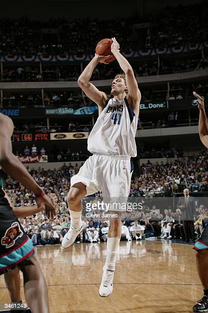 Dirk Nowitzki of the Dallas Mavericks shoots a jumper against the Memphis Grizzlies during the game at American Airlines Arena on April 13 2004 in...
