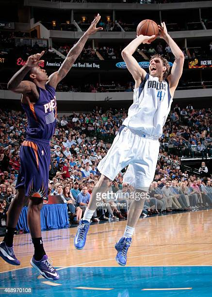 Dirk Nowitzki of the Dallas Mavericks shoots a jumper against the Phoenix Suns on April 8 2015 at the American Airlines Center in Dallas Texas NOTE...