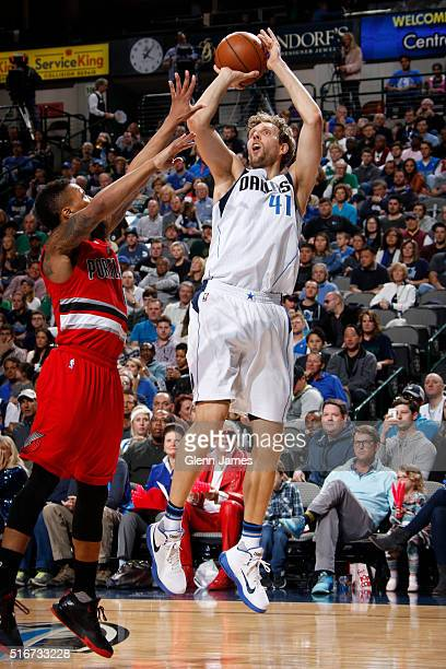 Dirk Nowitzki of the Dallas Mavericks shoots a jumper against the Portland Trail Blazers on March 20 2016 at the American Airlines Center in Dallas...