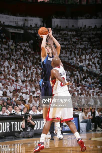 Dirk Nowitzki of the Dallas Mavericks shoots against Antoine Walker of the Miami Heat during Game Three of the 2006 NBA Finals on June 13 2006 at the...