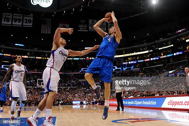 Dirk Nowitzki of the Dallas Mavericks shoots against Blake Griffin of the Los Angeles Clippers at Staples Center on April 3 2014 in Los Angeles...