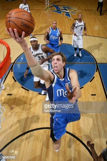 Dirk Nowitzki of the Dallas Mavericks shoots against Brendan Haywood of the Washington Wizards at the Verizon Center on January 20 2010 in Washington...