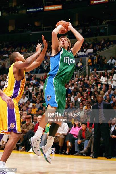 Dirk Nowitzki of the Dallas Mavericks shoots against Brian Cook of the Los Angeles Lakers during a game at Staples Center on December 20 2005 in Los...