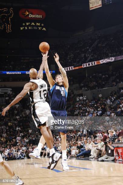 Dirk Nowitzki of the Dallas Mavericks shoots against Bruce Bowen of the San Antonio Spurs in game two of the Western Conference Semifinals during the...