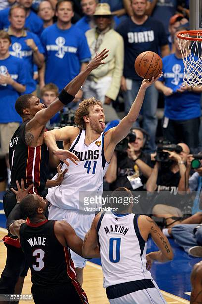 Dirk Nowitzki of the Dallas Mavericks shoots against Chris Bosh of the Miami Heat during Game Five of the 2011 NBA Finals on June 9 2011 at the...