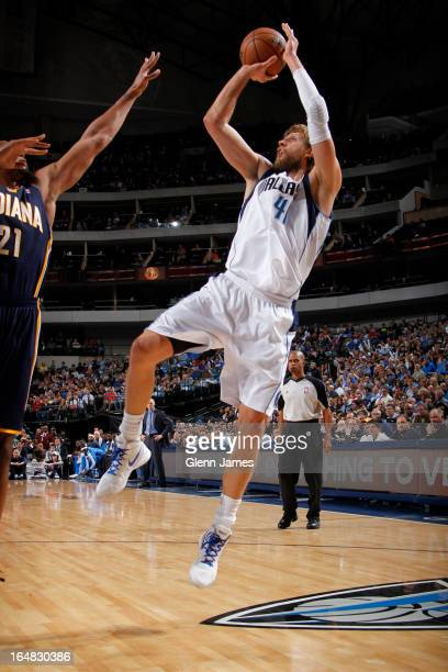 Dirk Nowitzki of the Dallas Mavericks shoots against David West of the Indiana Pacers on March 28 2013 at the American Airlines Center in Dallas...