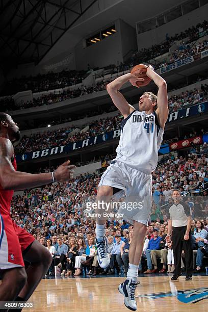 Dirk Nowitzki of the Dallas Mavericks shoots against DeAndre Jordan of the Los Angeles Clippers on March 27 2014 at the American Airlines Center in...