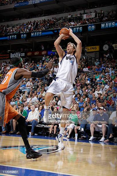 Dirk Nowitzki of the Dallas Mavericks shoots against Hakim Warrick of the Phoenix Suns during a game on April 10 2011 at the American Airlines Center...