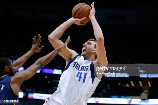 Dirk Nowitzki of the Dallas Mavericks shoots against Ian Clark of the New Orleans Pelicans during a game at the Smoothie King Center on December 28...