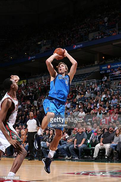 Dirk Nowitzki of the Dallas Mavericks shoots against John Henson of the Milwaukee Bucks on November 9 2013 at the BMO Harris Bradley Center in...