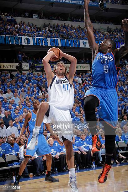 Dirk Nowitzki of the Dallas Mavericks shoots against Kendrick Perkins of the Oklahoma City Thunder during Game Two of the Western Conference Finals...