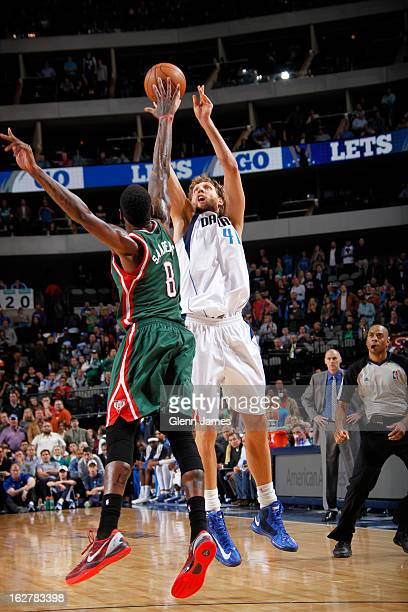 Dirk Nowitzki of the Dallas Mavericks shoots against Larry Sanders of the Milwaukee Bucks on February 26 2013 at the American Airlines Center in...
