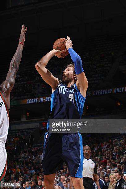 Dirk Nowitzki of the Dallas Mavericks shoots against Larry Sanders of the Milwaukee Bucks on March 12 2013 at the BMO Harris Bradley Center in...