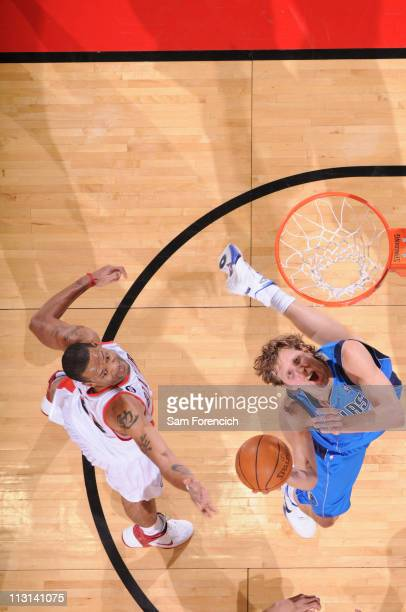 Dirk Nowitzki of the Dallas Mavericks shoots against Marcus Camby of the Portland Trail Blazers in Game Four of the Western Conference Quarterfinals...