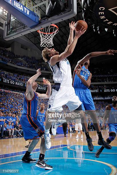 Dirk Nowitzki of the Dallas Mavericks shoots against Nick Collison and Kevin Durant of the Oklahoma City Thunder during Game Five of the Western...