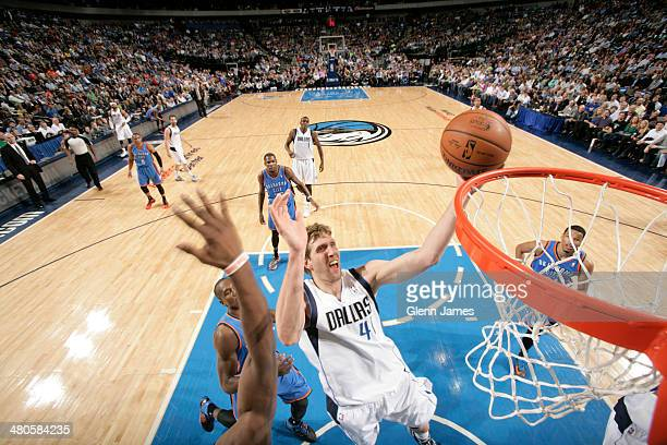 Dirk Nowitzki of the Dallas Mavericks shoots against Serge Ibaka of the Oklahoma City Thunder on March 25 2014 at the American Airlines Center in...