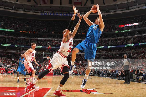 Dirk Nowitzki of the Dallas Mavericks shoots against Taj Gibson of the Chicago Bulls on April 21 2012 at the United Center in Chicago Illinois NOTE...