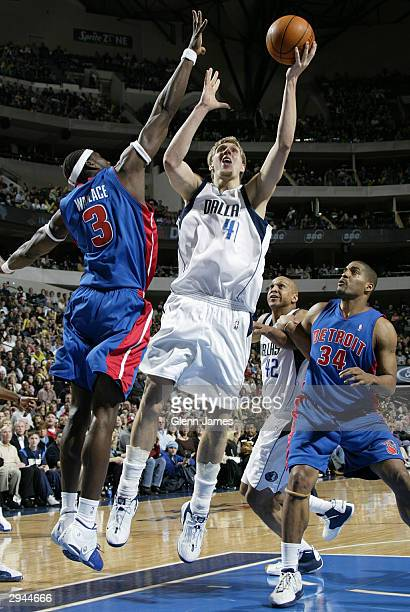 Dirk Nowitzki of the Dallas Mavericks shoots against the Detroit Pistons on February 7 2004 at the American Airlines Center in Dallas Texas NOTE TO...