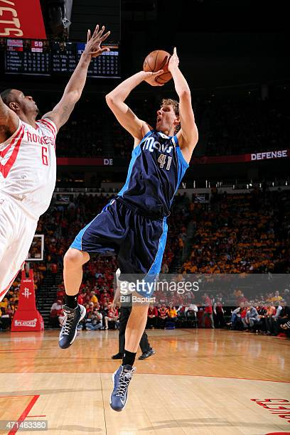 Dirk Nowitzki of the Dallas Mavericks shoots against the Houston Rockets in Game Five of the Western Conference Quarterfinals during the NBA Playoffs...