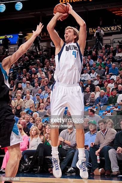 Dirk Nowitzki of the Dallas Mavericks shoots against the Minnesota Timberwolves on January 14 2013 at the American Airlines Center in Dallas Texas...