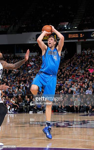 Dirk Nowitzki of the Dallas Mavericks shoots against the Sacramento Kings on November 30 2015 at Sleep Train Arena in Sacramento California NOTE TO...