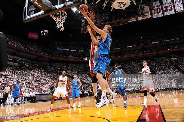Dirk Nowitzki of the Dallas Mavericks shoots against Udonis Haslem of the Miami Heat during Game One of the 2011 NBA Finals on May 31 2011 at the...