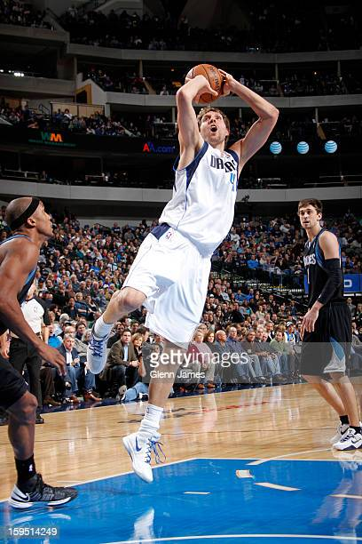 Dirk Nowitzki of the Dallas Mavericks shoots in the lane against Dante Cunningham of the Minnesota Timberwolves on January 14 2013 at the American...