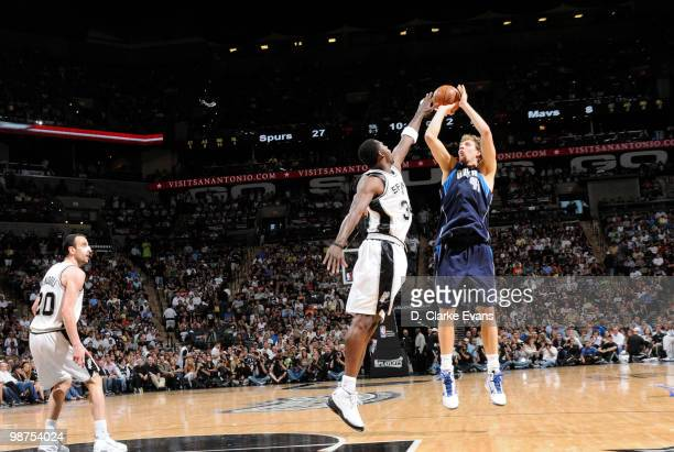 Dirk Nowitzki of the Dallas Mavericks shoots over Antonio McDyess of the San Antonio Spurs in Game Six of the Western Conference Quarterfinals during...